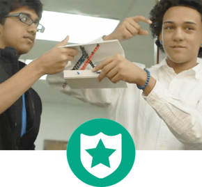 two male students presenting their prototypes