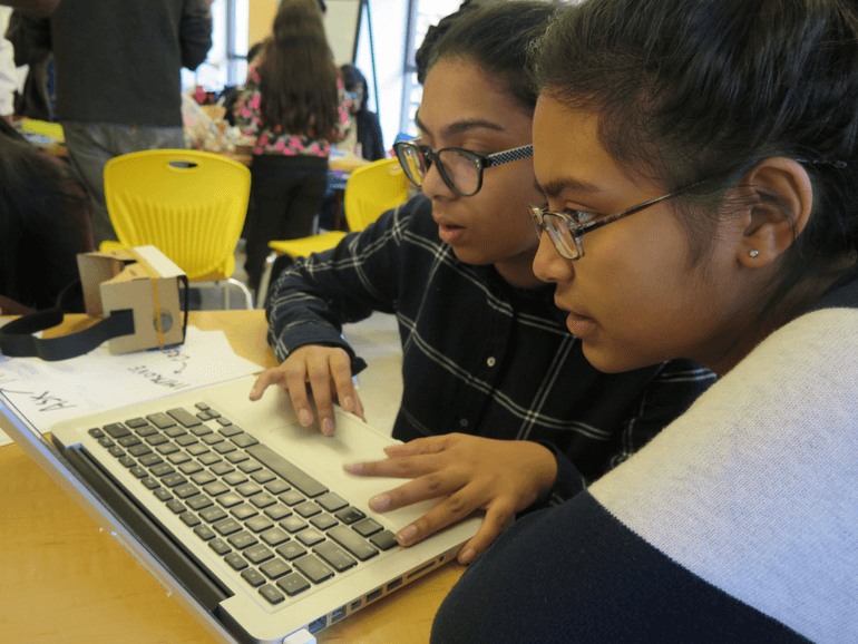 female students working together on the computer